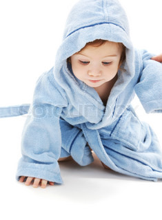 crawling baby boy in blue robe over white