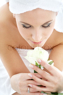 happy girl with white rose in spa