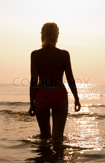 fit blond at the beach silhouette image