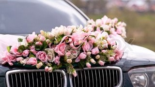 Wedding car decorated with bunch of flowers