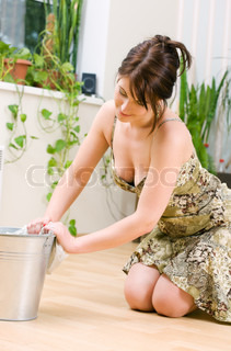 bright picture of lovely housewife cleaning floor