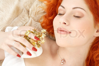 dreaming redhead girl with white christmas bells