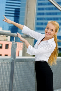 happy businesswoman in a front of building site