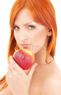 redhead woman with red apple over white