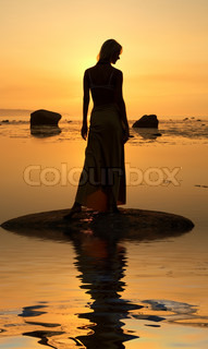 silhouette image of beautiful lady at the seashore