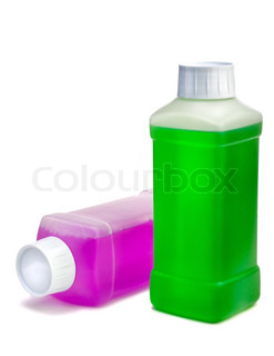 Two transparent plastic bottles with color cleaning liquid One standing and one lying