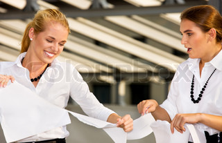 bright picture of two angry businesswomen fighting