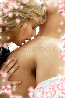 intimate color image of sensual couple foreplay with flowers