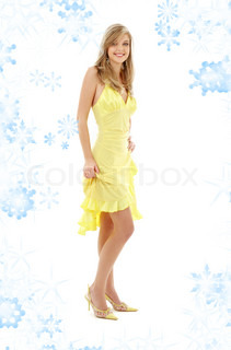 classical pin-up image of pretty lady in yellow dress with snowflakes