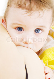 picture of baby boy sucking from mother breast
