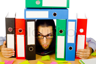 Businessman with many folders on white