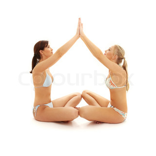 two girls with hands connected making home symbol