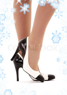 closeup picture of female legs in high heels shoes