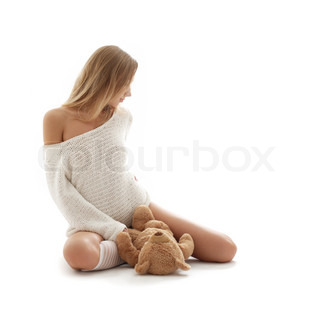 picture of lovely blond in white sweater with teddy bear