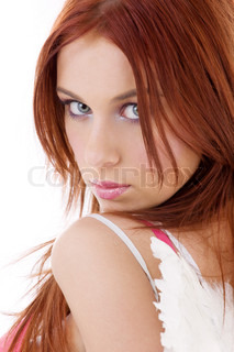 portrait of redhead angel girl over white