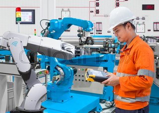 Maintenance engineer programing automated robotic at industry 4.0 concept