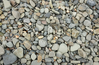 Natural grey stones on the beach, great for background and texture