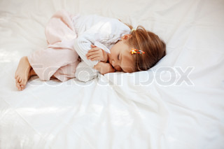 Portrait of child lying in her bed