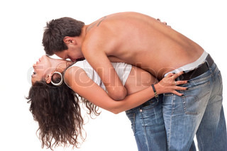 Man embrace his girlfriend and kiss in the neck
