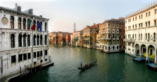 Panoramic view on famous Grand Canal among old historic buildings as seen from Rialto Bridge in Venice, Italy