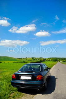 Car is parked in road side with a beautiful landscape