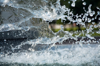 Splashes of water in city fountain