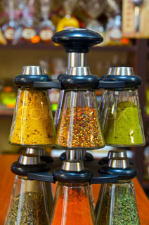 Different spices on the counter of market