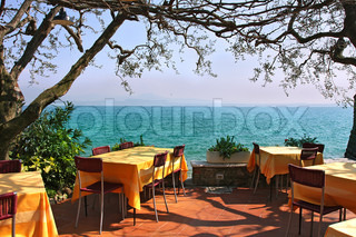 An outdoor restaurant with beautiful view on Lake Garda in Sirmione, Italy