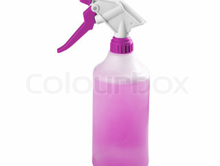 Spray bottle with blank label isolated on a white