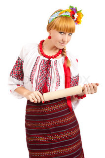 Housewife with rolling pin Woman wears Ukrainian national dress isolated on white background