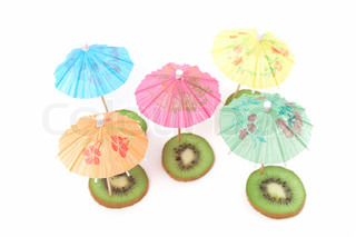 cocktail umbrellas on the slices of kiwi