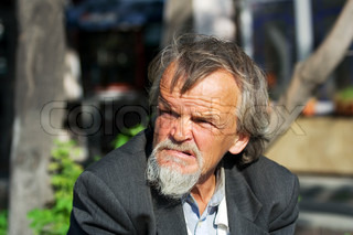 Sad elderly tramp