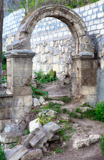 Arch dilapidated entrance to old Abandoned cemetery in the vicinity of Sevastopol Tovn (Crimea, Ukraine)