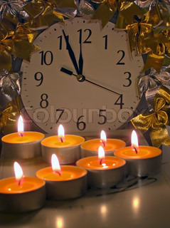 Christmas - New Year composition with midnight time clock, and tea candles model