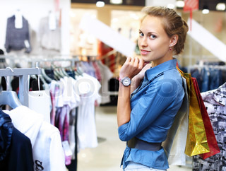 Young woman in a shop buying clothes