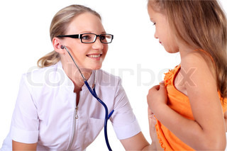 Young female doctor doing medical examination to a child