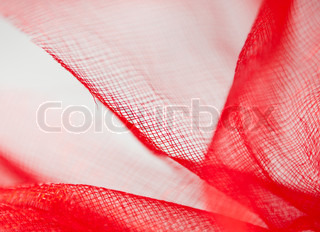 Red fabric texture on a white background