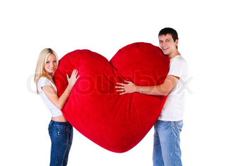 Young couple with a big heart on white background