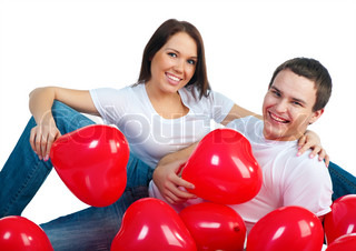 Young couple with a hearts over white background