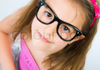 Pretty young girl in glasses against isolated white background