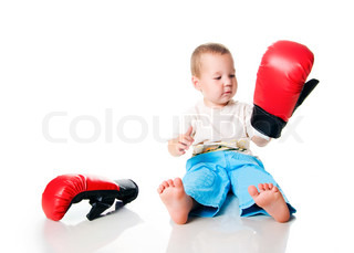 Cute little boy with the boxing gloves