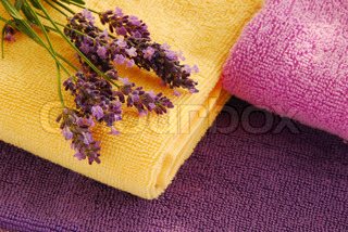 magenta, purple and yellow towels with lavender flowers