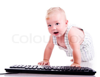 Little child holding keyboard isolated over white