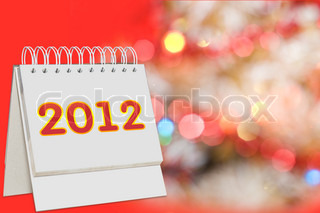 calendar with 2012  sign over Christmas background