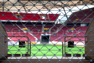 View on a soccer stadium through locked gate