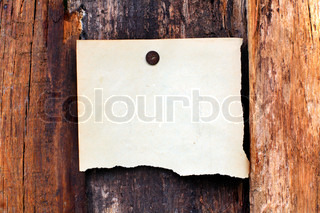 blank paper hanging on the wooden background