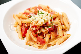 Pasta with tomato sauce and herbs