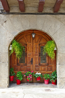 Detail of the Facade of Spanish Homes Decorated with Flowers