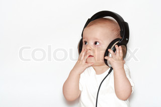 small boys with headphones