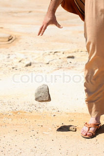 Forgiveness. Symbolic concept of man dropping a stone from his hand